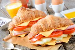 breakfast-set-up-croissants-sandwiches-wooden-table-selective-focus-front-croissant-sandwich-40903608